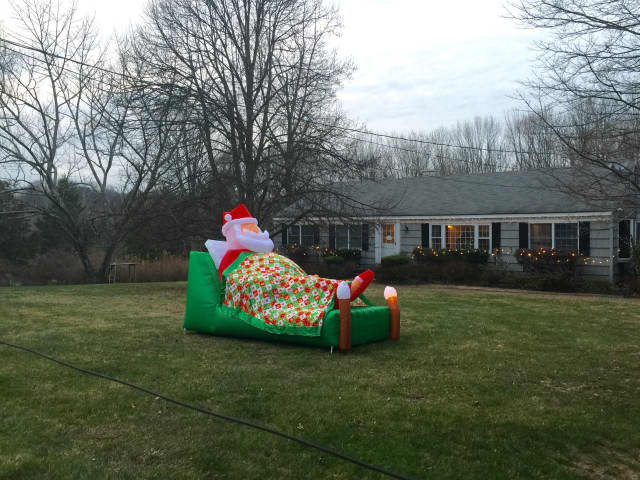 Santa is catching a few winks -- and sparking smiles -- before his big delivery day. You can catch the holiday bug by enjoying the Christmas display on Bouton Road in South Salem.