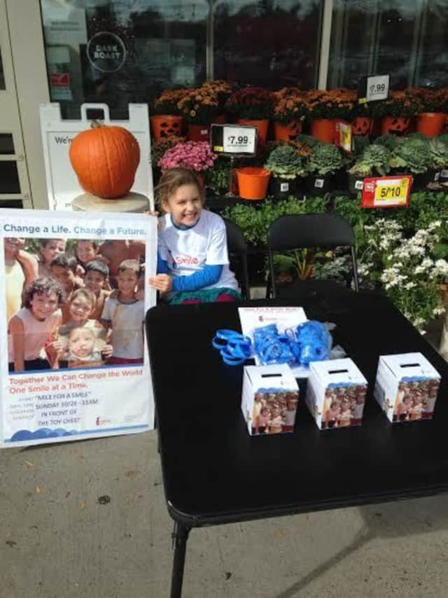 Ridgefield's Isabel Christofor fundraising at Stop & Shop last October for the Mile For A Smile walk.