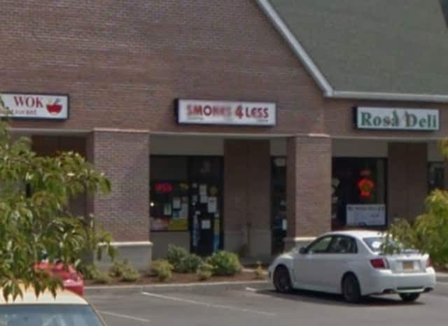 Smokes 4 Less, a LaGrangeville store that sells tobacco, cigars and smoking accessories, was robbed by a baseball-bat wielding suspect Tuesday, police say.