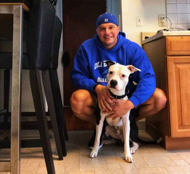 Cliffside Park resident  and Ridgefield Police Officer Kevin Nebbia with Spanky.