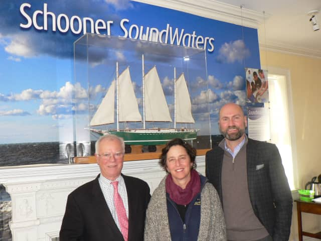 Dr. Leigh Shemitz, center, president of SoundWaters, flanked by board chairmen Tom O'Connell, left, of the Young Mariners Foundation and Scott Mitchell of SoundWaters, at the SoundWaters Coastal Education Center on Cove Island.