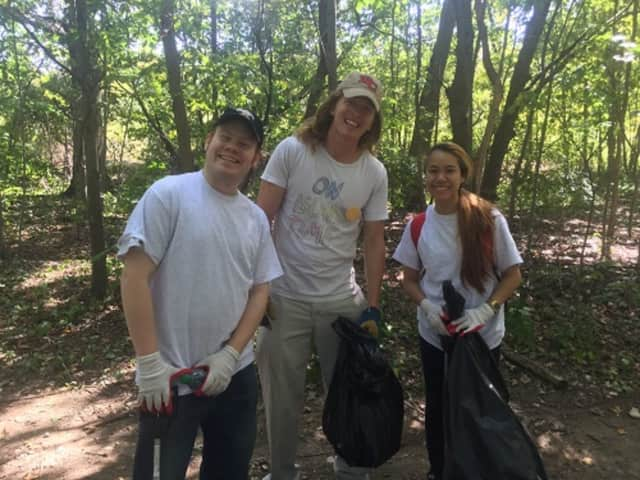 Volunteers helped clean up the area of a pond, part of the Five Mile River watershed, Saturday on Norwalk Community College's West Campus. From left are: Nate Seper, Rob Knechtle and Sally Srikaew.