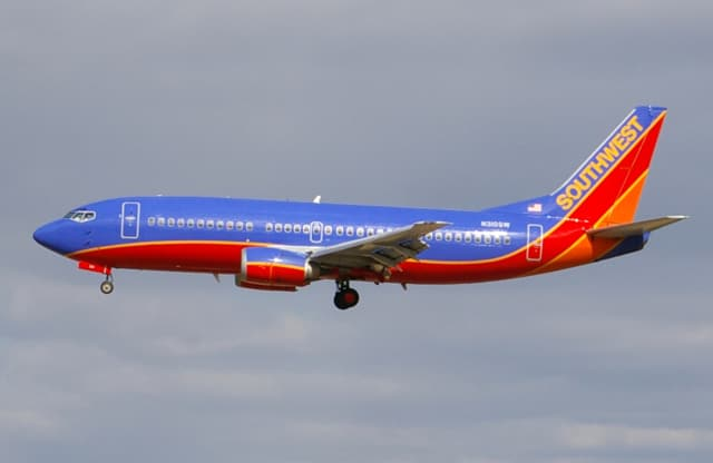 A Pleasant Valley man is suing Southwest Airlines for injuries he says were sustained during a 2013 crash landing at LaGuardia Airport.