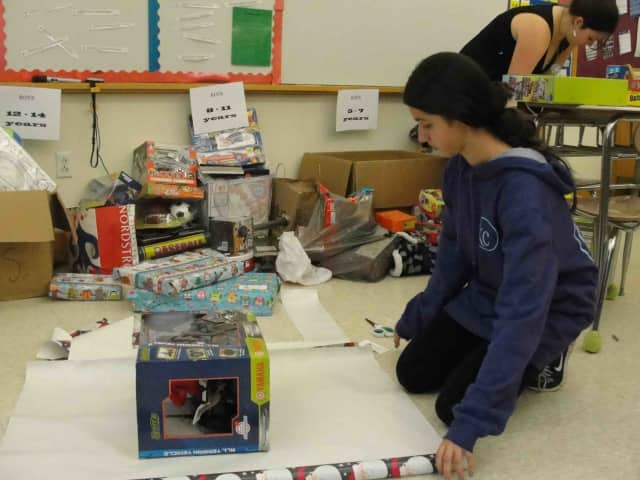 Irvington Middle School students and teachers worked to wrap the 501 toys collected by the school to donate to Open Door Family Medical Center in Sleepy Hollow.