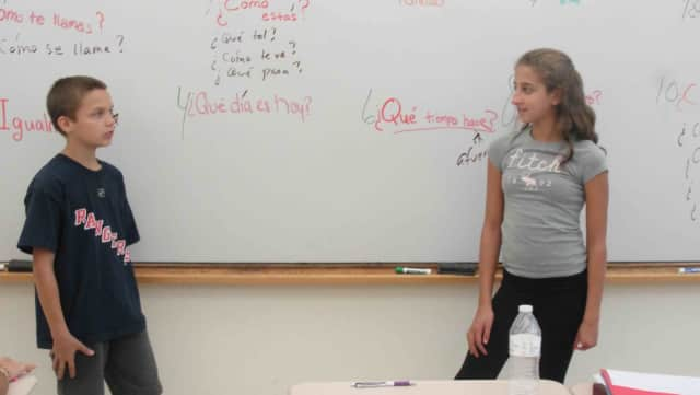 Irvington Middle School seventh-graders in Angela Druzic's Spanish class had conversations with each other in Spanish.