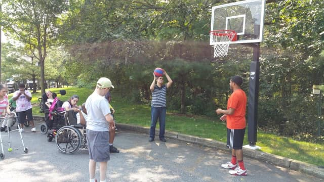 Residents from Spectrum for Living, a special needs facility, enjoy some outdoor recreation. The Ridgewood Library and the Access for All committee will have a program on transitioning special needs children from teen to adult Oct. 1 at the library.