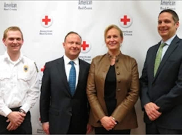 Mark and MaryGrace Gudis, along with Mike Daglio, president of Norwalk Hospital, and Matt Soicher, director of EMS at Norwalk Hospital