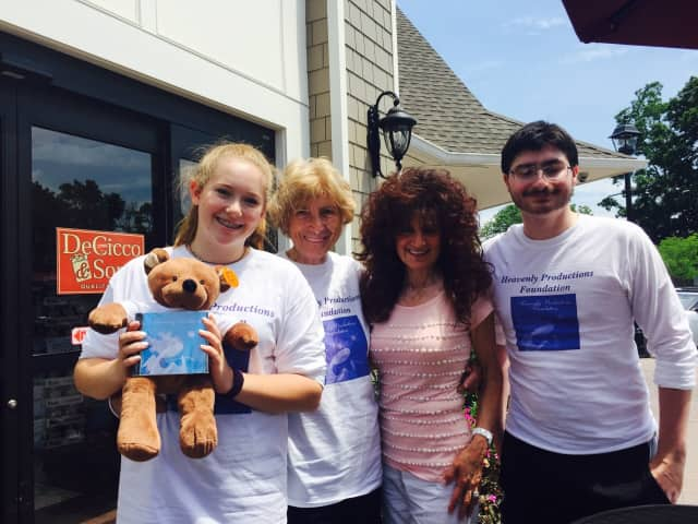 "HPF volunteers outside of DeCicco's & Sons Family Market at the ""Sponsor a Teddy Bear"" event on Friday, July 1 -- From Left: Kathryn Eisenhower, Anne Reilly, Marie DeCicco, owner of DeCicco's, and James Papazian."