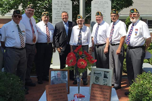 Rep. Sredzinski (fourth from right) joins members of American Legion Post 176 at a brick-laying ceremony to honor two World War II veterans.