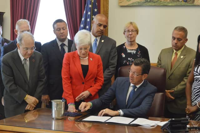 The bill signing takes place on Tuesday afternoon in the Governor's Office at the State Capitol.