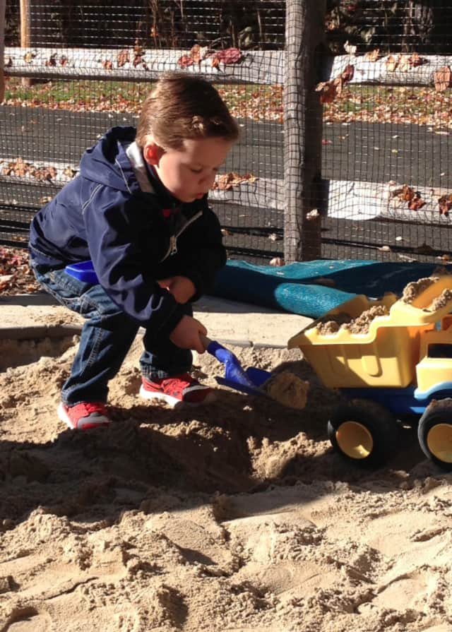 Anders Nelson enjoys outdoor playtime in the St. John Preschool playground. The school will be adding a drop off program for toddlers.