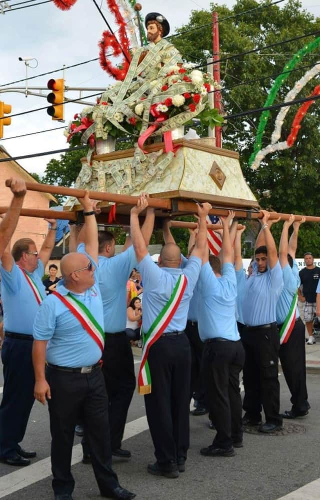 Members carrying the statue of their patron saint.