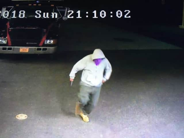 Investigators from the Fairfield Police Department released surveillance photos of a suspect who allegedly wielded a knife and made off with an undisclosed amount of cash.