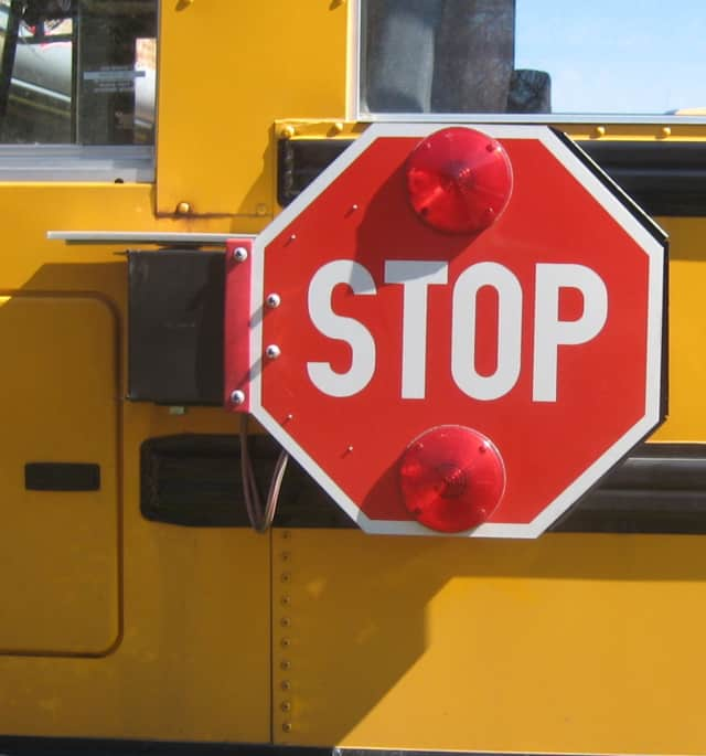 An unidentified school bus monitor was hit by a bus this morning on Columbus Avenue.