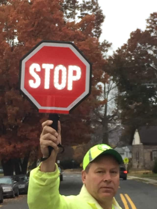 Northvale crossing guard Kurt Sidorak uses a new LED flashing stop sign.