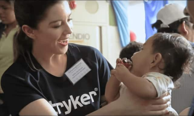 A Stryker employee volunteers with Operation Smile.