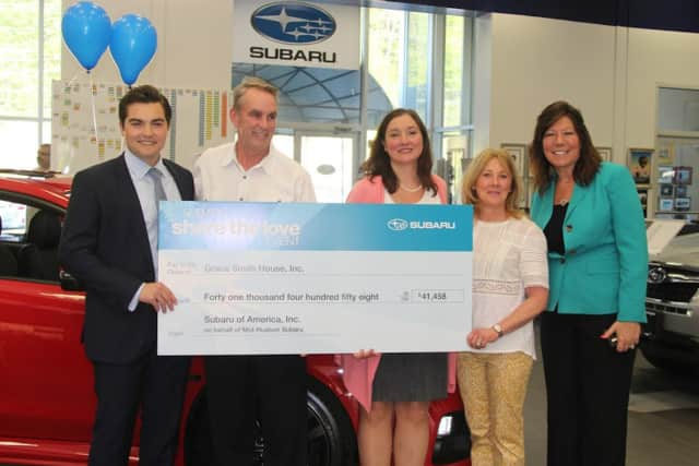 Mid-Hudson Subaru presents check to Grace Smith House.