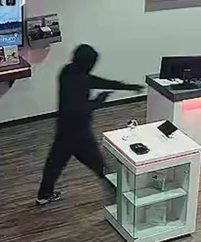 The suspect is described as a black male, about 5-foot-8 with a thin build, wearing all black with a black hoodie, black mask and black gloves.
