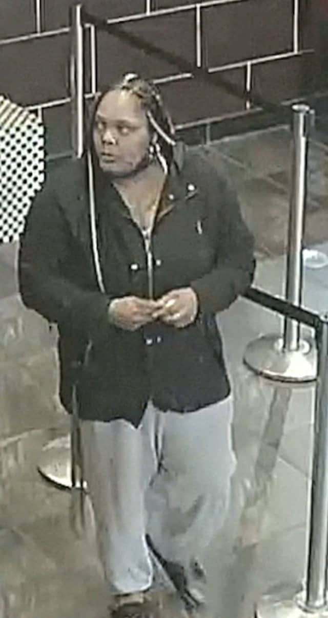 This woman is at large after punching a Long Island restaurant employee, police say.