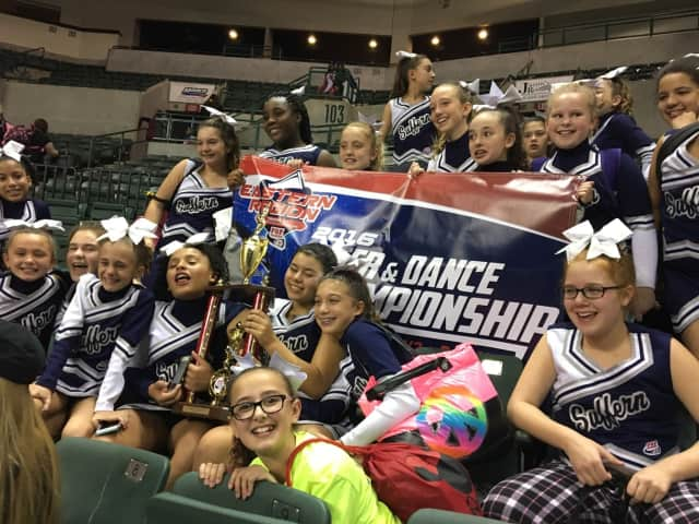 The Suffern Midget Mounties peewee cheer squad is heading to the national Pop Warner cheer competition at Disney World on Dec. 7.