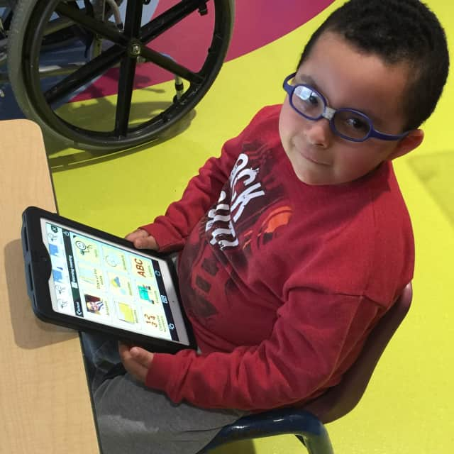 Antonio uses an app on his tablet to communicate at the Sunshine Children's Home Home & Rehabilitation Center.