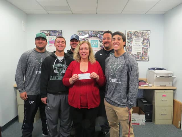 Steven Veteri, Brandon Meyreles, Justin Cavallo, Dom Cioffi and Coach Mike Rescigno with Katherine  Quinn, executive director of Support Connection.