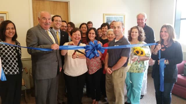 Susan Balamaci cuts the ribbon for her new business in Mount Kisco.