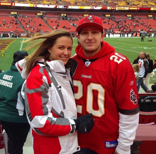 Newlywed health care heroes and Tampa Bay super fans Kimberly Smith and Maciej Mazurkiewicz.