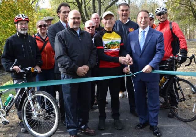 Rob Astorino and cyclists help open the final stretch of the South County Trailway