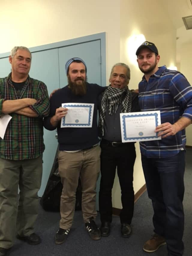 Accepting their CPR Save Awards are (from left to right): Mike Farley, Matt Weir, Alaric Young and Ian Schwartz.
