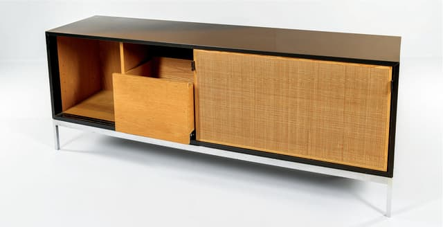 Florence Knoll's work was pioneering. Here, a woven cane door credenza. Courtesy Skinner Inc.