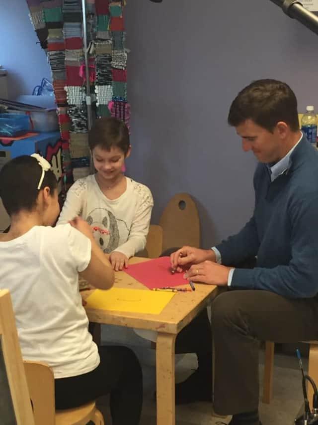 Giants quarterback Eli Manning visits with childhood cancer patients at Hackensack University Medical Center.