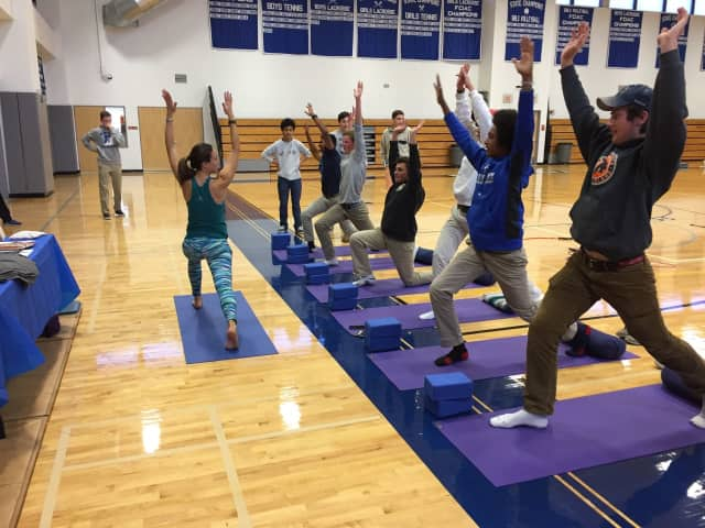Talita Moss teaching students yoga at Darien High School's recent health fair.