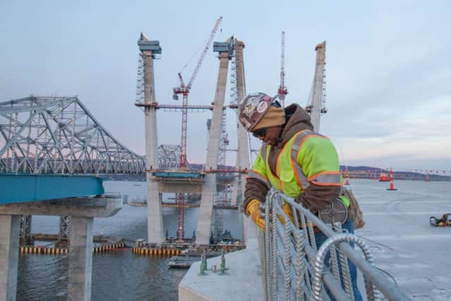 An ironworker ties steel reinforcement for a concrete barrier on the new Tappan Zee Bridge.