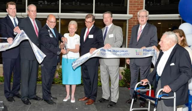 Ribbon cutting of the new lobby (l-r): Glen Taylor, Phelps VP, support services; Kevin Plunkett; Daniel Blum; Eva Marie Dahling; Richard Sinni; Sen. Terrence Murphy; Dennis Connors, Northwell Sr. VP, regional executive director; and David Rockefeller