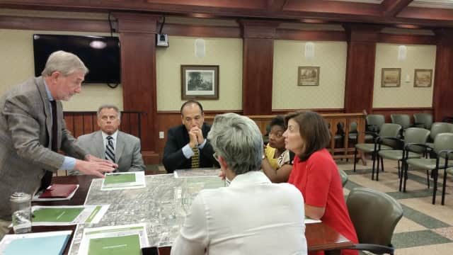 From righ,: Lt. Gov. Kathy Hochul, Sen. Andrea Stewart-Cousins and Tarrytown Mayor Drew Fixell confer at a meeting during their Tarrytown tour on Wednesday.