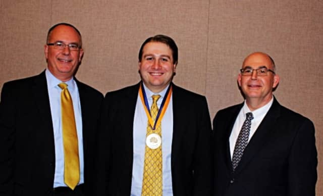 Mark A. Thompson, executive vice president and provost at Quinnipiac University, Ted Koly and Matthew O'Connor, dean of the School of Business and Engineering. Koly has received a 2015 Alumni Award from Quinnipiac University.