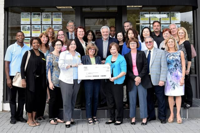 Judith Giordano, manager of the Weichert Realtors' Tenafly office, present Cynthia Massarsky, president of Make-It-Home, with a check to support Bergen County's United Way Very Special Homes initiative.