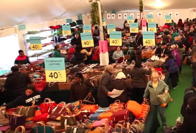 Shoppers crowd the tent at last year's sample sale for Dooney & Bourke in Norwalk.