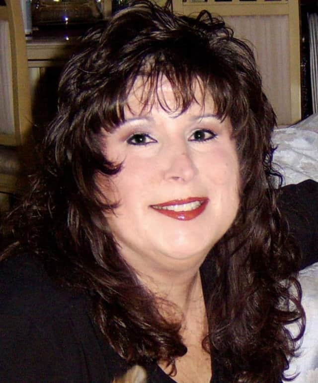 Teresa -- a psychic medium and pet psychic -- will be at Hawthorne's library on May 19.
