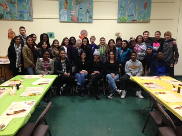 Twenty-eight students from Walter Panas High School's Inter-Ethnic/United Nations Club met at the United Methodist Church in Peekskill to set up the dining room to feed about 180+homeless and needy people on Thanksgiving.