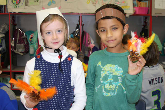 """Holmes School second-graders Caitlin Cronin and Yohan Aggarwal from Mrs. Robbins' class crafted """"pinecone turkeys"""" as a part of a Thanksgiving celebration in their classroom."""
