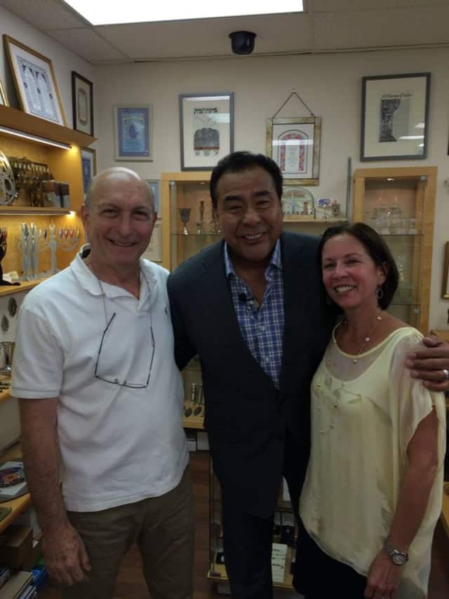 """Ruth and Shimon Zimerman posing with news correspondent John Quinones, host of ABC's """"What Would You Do?"""""""
