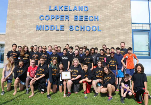 The Lakeland Copper Beech Middle School Honors Band holds the gold rating certificate earned at the NYSSMA Band Majors Festival