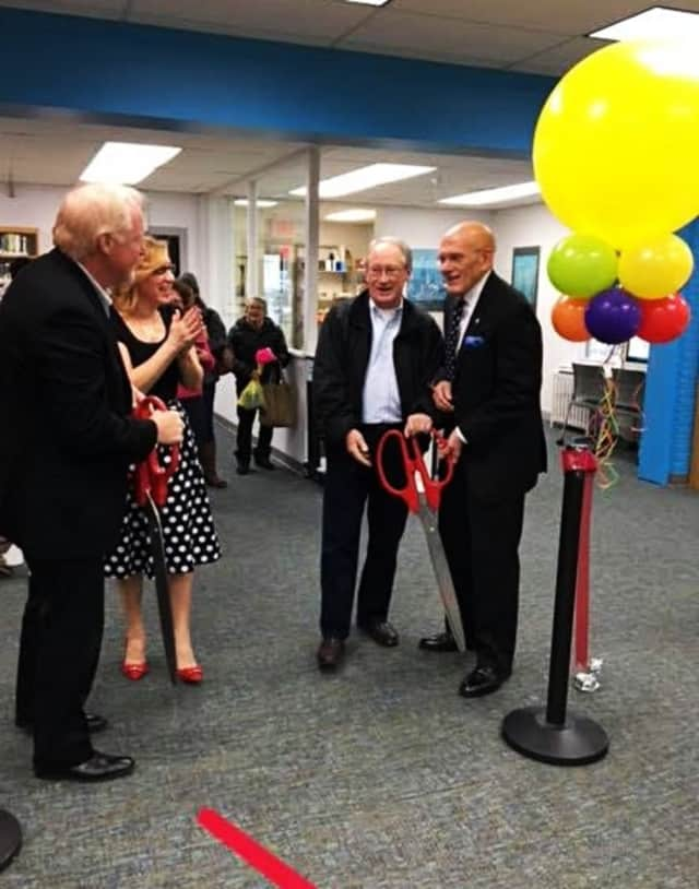 Mayor Ron Belmont, right, helped celebrate the West Harrison Library's grand reopening this Monday.