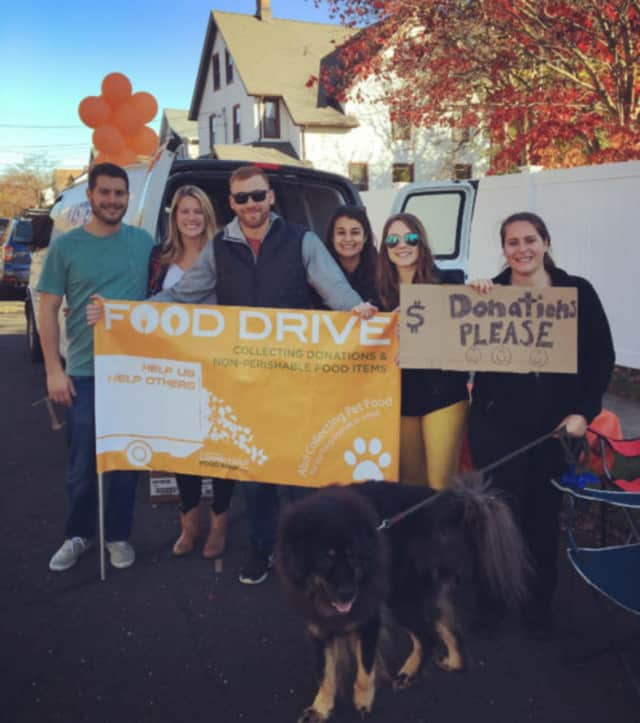 "Theresa Paulovic hosts her second annual ""Fill-A-Van"" food drive in her neighborhood in Norwalk."