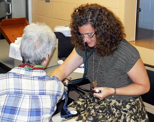 Here Theresa Cudequest checks blood pressure at another NWBRHC clinic.