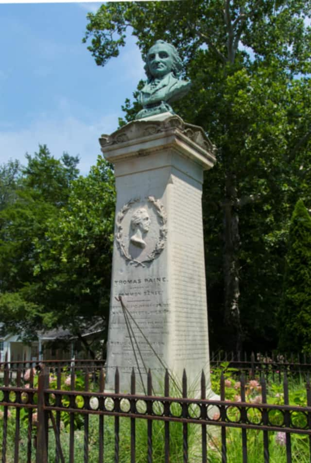 The Thomas Paine monument in New Rochelle. The city's attributes are mentioned in a New York Times article.
