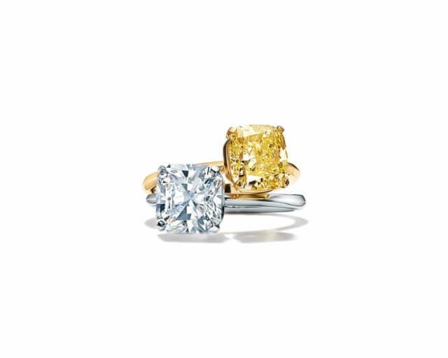 Tiffany True engagement rings in platinum with a white diamond and 18-karat gold with a fancy yellow diamond. Courtesy Tiffany & Co.