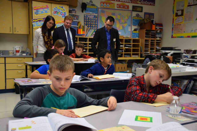 Vivian Cheng, area director of Marshall Cavendish; Greg Soldatenko, general manager of East West Math, LLC; and Peng Yim Siew, CEO of Marshall Cavendish, recently visited Todd Elementary School to observe a fourth-grade mathematics class.